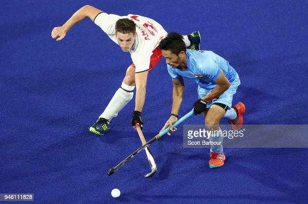 Ollie Willars of England and Kothajit Singh Khadangbam of India compete for the ball during the Men's Bronze Medal match between England and India...