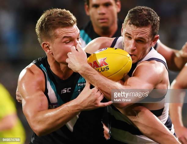 Ollie Wines of Port Adelaide and Joel Selwood of the Cats during the round five AFL match between the Port Adelaide Power and the Geelong Cats at...