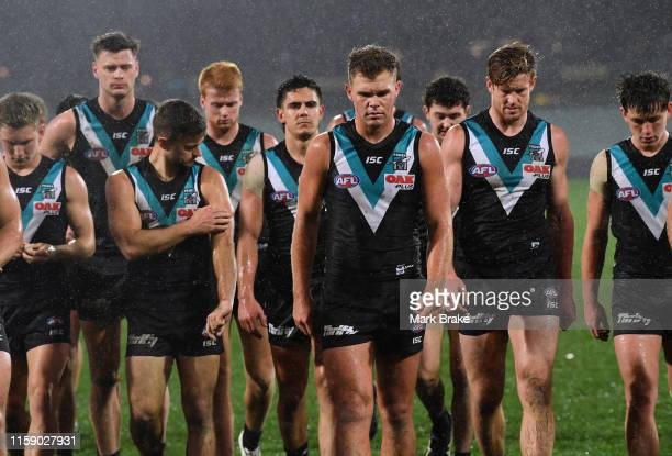Ollie Wines of Port Adelaide leas his team off the ground during the round 15 AFL match between the Port Adelaide Power and the Western Bulldogs at...
