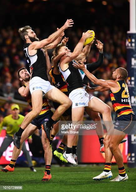 Ollie Wines of Port Adelaide marks in front of Justin Westhoff of Port Adelaide and Cam EllisYoleman of the Adelaide Crows during the round 20 AFL...