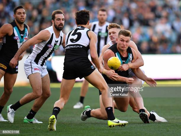 Ollie Wines of the Power is tackled by Adam Treloar of the Magpies during the round 21 AFL match between Port Adelaide Power and the Collingwood...