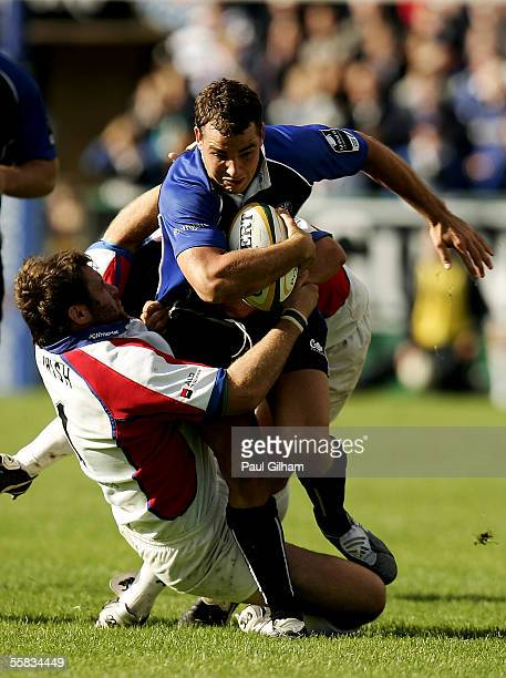 Olly Barkley of Bath is challenged by Mark Irish of Bristol Rugby during the Powergen Cup match between Bath Rugby and Bristol Rugby at The...