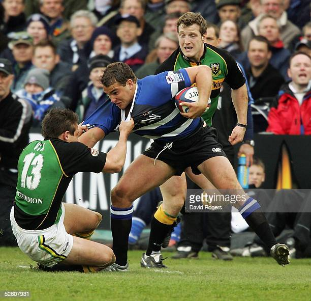 Olly Barkley of Bath is tackled by Andy Vilk during the Zurich Premiership match between Bath and Northampton Saints at The Recreation Ground on...