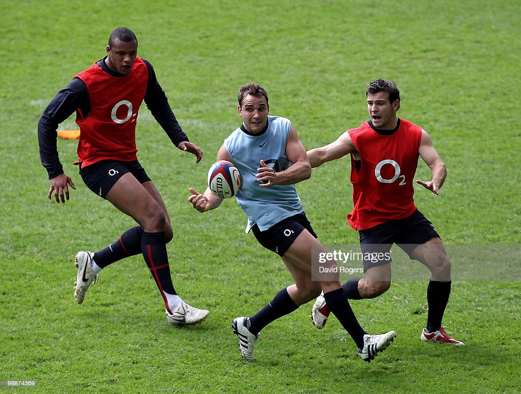 Olly Barkley passes the ball watched by Courtney Lawes(L) and Danny Care during an England training session held at Twickenham on May 18, 2010 in Twickenham, England.