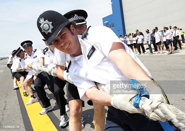 Olly Chapman of the Metropolitan Police Services in London and team pull a Jet Blue A320 plane 100 feet during the third annual Jet Blue Airbus A320...
