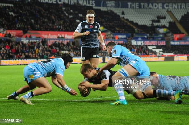 Olly Cracknell of Ospreys scores his sides first try during the Guinness Pro14 Round 8 match between the Ospreys and Glasgow Warriors at the Liberty...