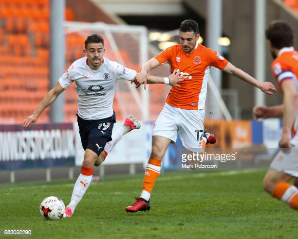 Olly Lee of Luton Town and Jordan Flores of Blackpool during the Sky Bet League Two match between Blackpool and Luton Town at Bloomfield Road on May...