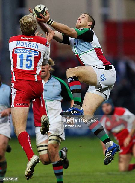 Olly Morgan of Gloucester contests with Mike Brown of Harlequins during the Guinness Premiership match between Gloucester and Harlequins at Kingsholm...