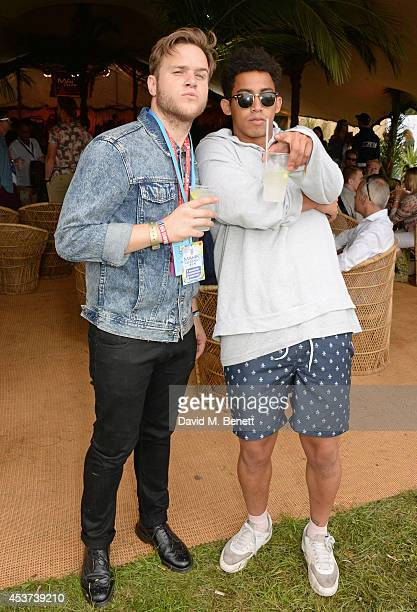 Olly Murs and Jordan Stephens attend the Mahiki Rum Bar for the launch of the Mahiki Rum Family backstage during day 2 of the V Festival 2014 at...