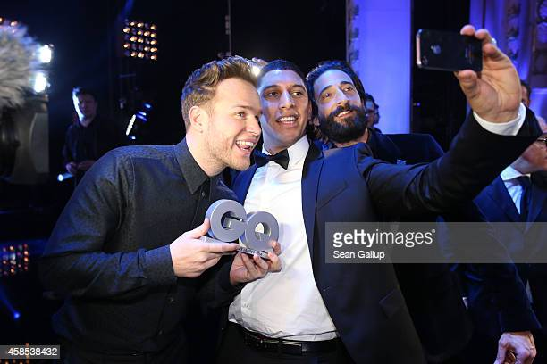Olly Murs Andreas Bourani and Adrien Brody are seen on stage at the GQ Men Of The Year Award 2014 at Komische Oper on November 6 2014 in Berlin...