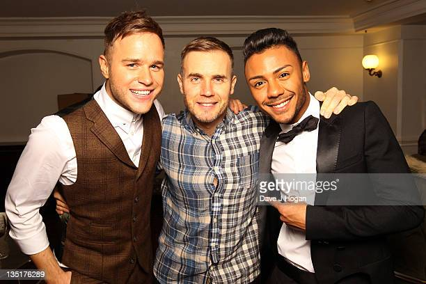 Olly Murs Gary Barlow and Marcus Collins pose backstage at a concert by Gary Barlow in aid of the Prince's Trust at The Royal Albert Hall on December...