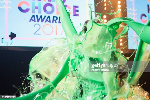 Olly Murs gets slimed by Jordan Banjo and Perri Kiely while receiving the UK Solo Megastar Honorary Award at the 2017 Nickelodeon's Kids' Choice...