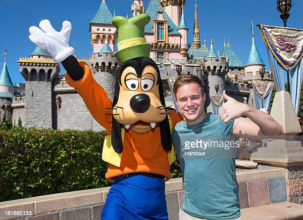 Olly Murs meets Goofy at Disneyland Park on September 22 2013 in Anaheim California