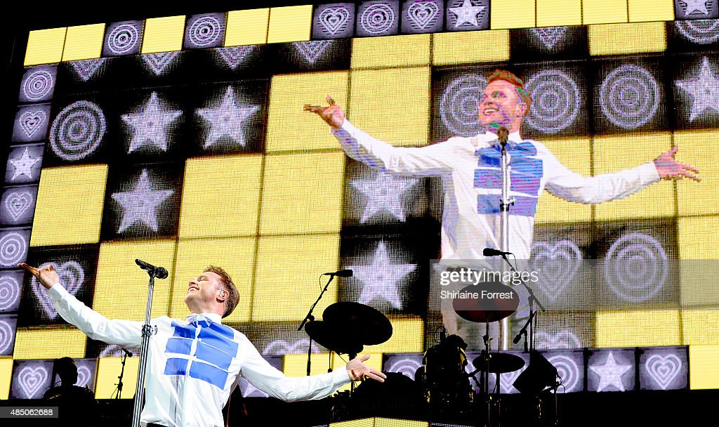 Olly Murs performs headlining the MTV stage on Day 2 of the V Festival at Weston Park on August 23, 2015 in Stafford, England.