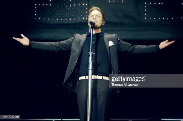 Olly Murs performs on stage at Metro Radio Arena on February 26 2013 in Newcastle upon Tyne England