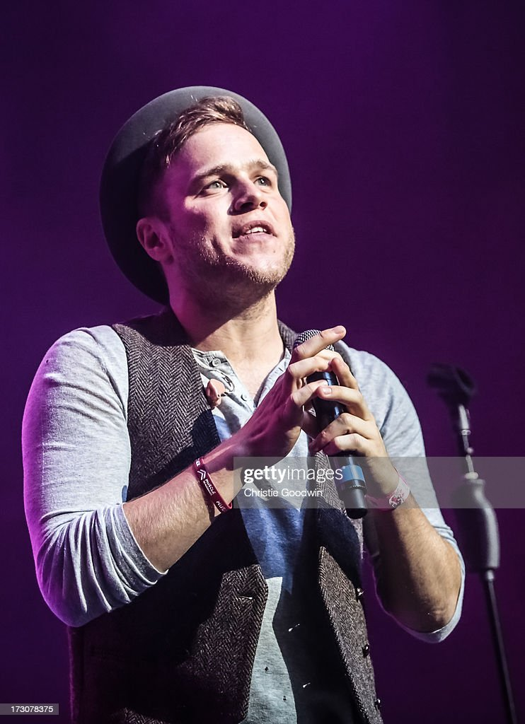 Olly Murs performs on stage during the Rays Of Sunshine charity concert at Royal Albert Hall on July 6, 2013 in London, England.
