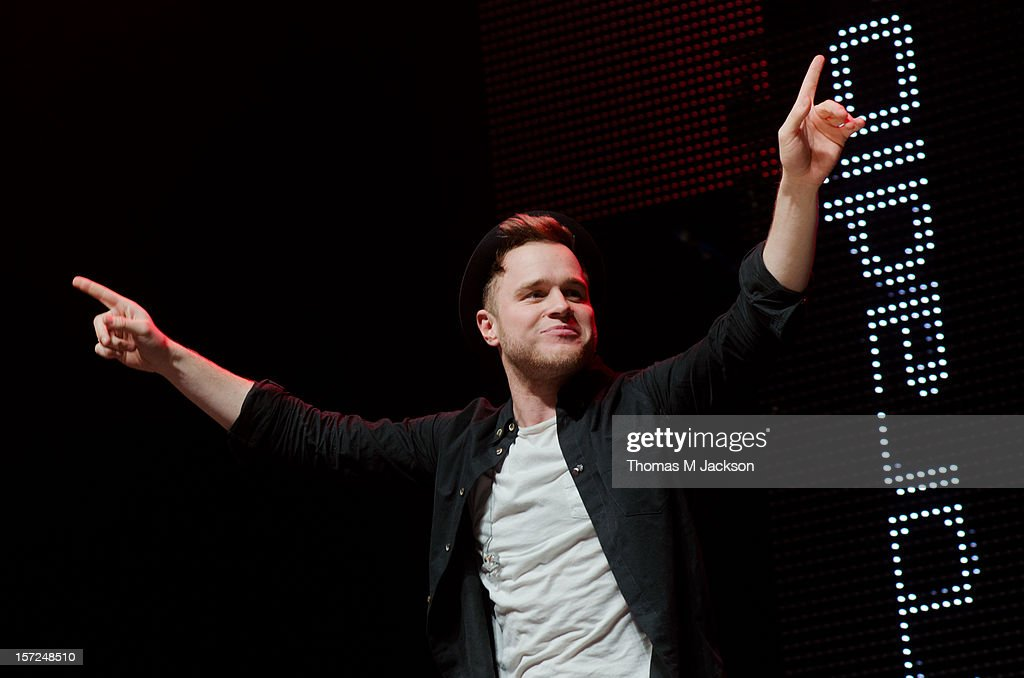 Olly Murs performs onstage at Metro Radio Live 2012 at Metro Radio Arena on November 30, 2012 in Newcastle upon Tyne, England.