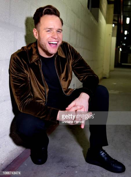 Olly Murs poses backstage after meeting fans and signing copies of his new album 'You Know I Know' at HMV Manchester on November 12 2018 in...