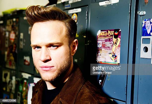 Olly Murs poses backstage before meeting fans and signing copies of his new album 'Never Been Better Special Edition' at HMV on November 23 2015 in...