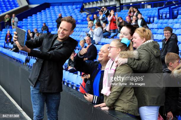 Olly Murs poses for pictures with the fans as he arrives for the Bradley Lowery charity match at Goodison Park Liverpool