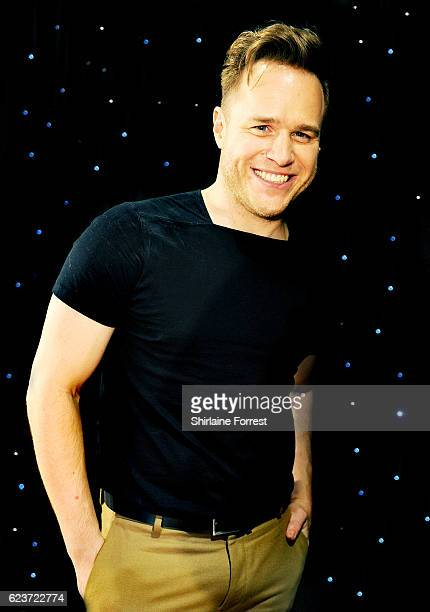 Olly Murs poses side of stage after meeting fans and signing copies of his new album '24 hrs' at HMV Intu Trafford Centre on November 16 2016 in...