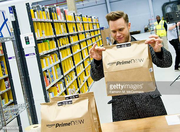 Olly Murs visits Amazon to pick pack and personally deliver surprise gifts to a family of fans using Amazon Prime Now onehour service on November 30...