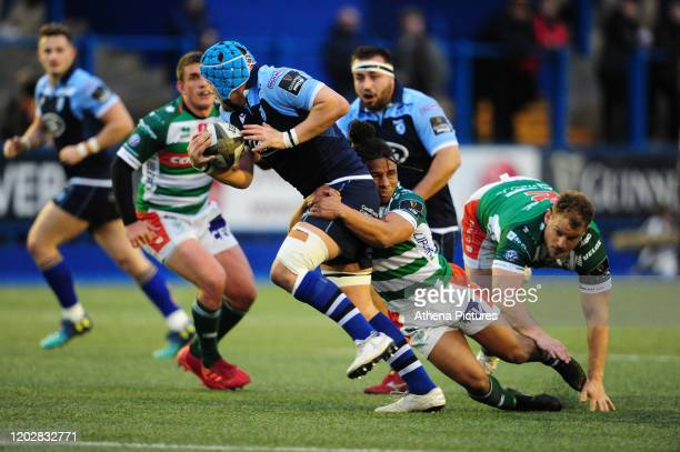 Olly Robinson of Cardiff Blues is tackled by Charly Trussardi of Benetton Treviso during the Guinness Pro14 Round 12 match between the Cardiff Blues...