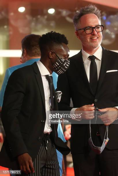 """Olly Sholotan and Director Kyle Rankin walk the red carpet ahead of the movie """"Run Hide Fight"""" at the 77th Venice Film Festival on September 10, 2020..."""