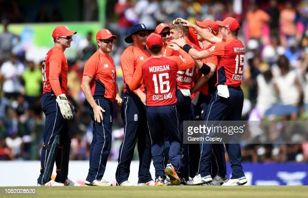 Olly Stone of England celebrates with teammates after taking his first ODI wicket of Niroshan Dickwella of Sri Lanka during the 2nd One Day...