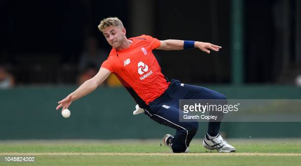 Olly Stone of England fields the ball from his own bowling during the tour match between Sri Lanka Cricket Board XI and England at P Sara Oval on...