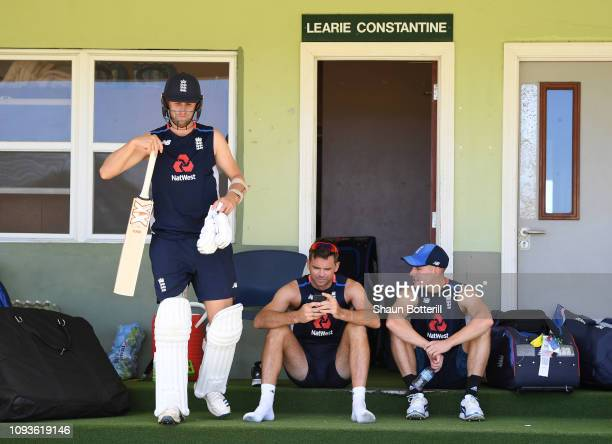 Olly Stone of England goes out to bat as teammates James Anderson and Rory Burns chat during net practice at the Three Ws Oval on January 13 2019 in...