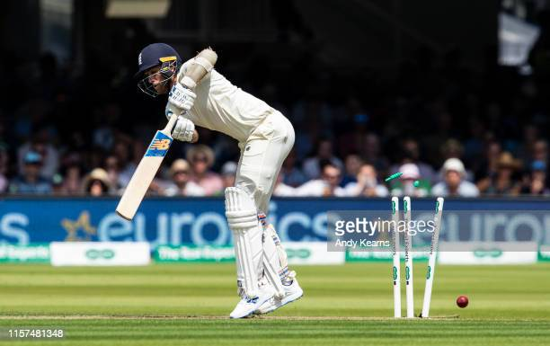 Olly Stone of England is bowled by Mark Adair of Ireland during day one of the Specsavers 1st Test match between England and Ireland at Lord's...