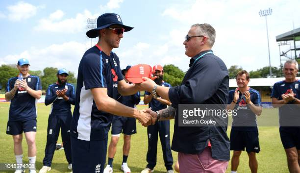 Olly Stone of England is presented his ODI cap by former fast bowler Darren Gough ahead of the 1st One Day International match between Sri Lanka and...