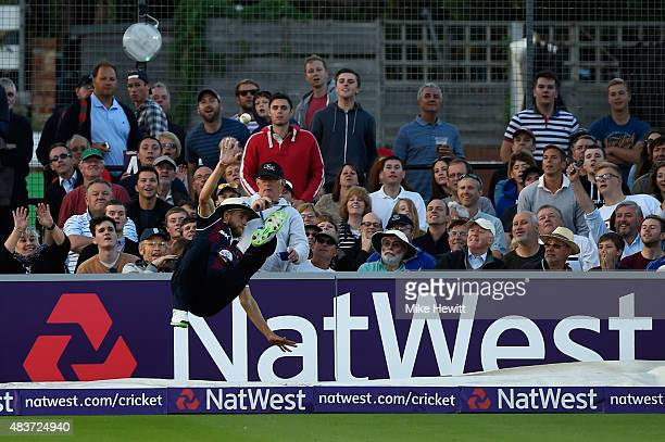 Olly Stone of Northamptonshire takes a spectacular catch on the boundary before throwing the ball back into play to avoid giving away a 6 during the...