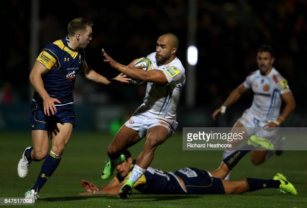 Olly Woodburn of Exeter avoids Perry Humphreys of Worcester during the Aviva Premiership match between Worcester Warriors and Exeter Chiefs at...