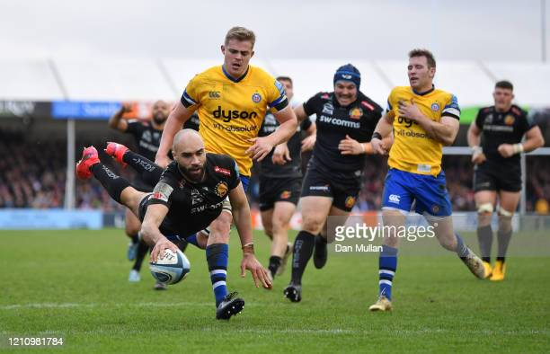 Olly Woodburn of Exeter Chiefs dives over to score his side's seventh try during the Gallagher Premiership Rugby match between Exeter Chiefs and Bath...