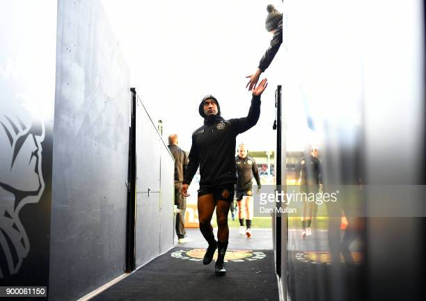 Olly Woodburn of Exeter Chiefs high fives a supporter prior to the Aviva Premiership match between Exeter Chiefs and Leicester Tigers at Sandy Park...