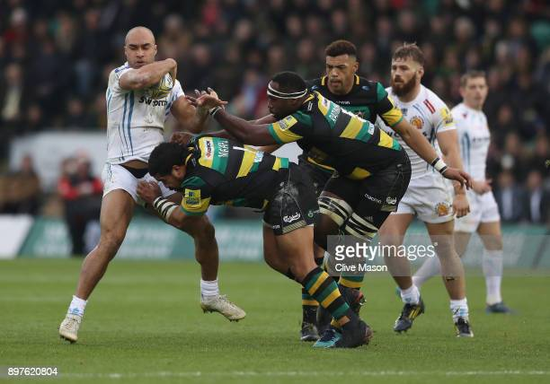 Olly Woodburn of Exeter Chiefs is tackled by Campese Ma'afu of Northampton Saints during the Aviva Premiership match between Northampton Saints and...