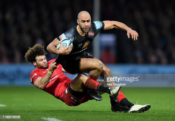Olly Woodburn of Exeter Chiefs is tackled by Duncan Taylor of Saracens during the Gallagher Premiership Rugby match between Exeter Chiefs and...