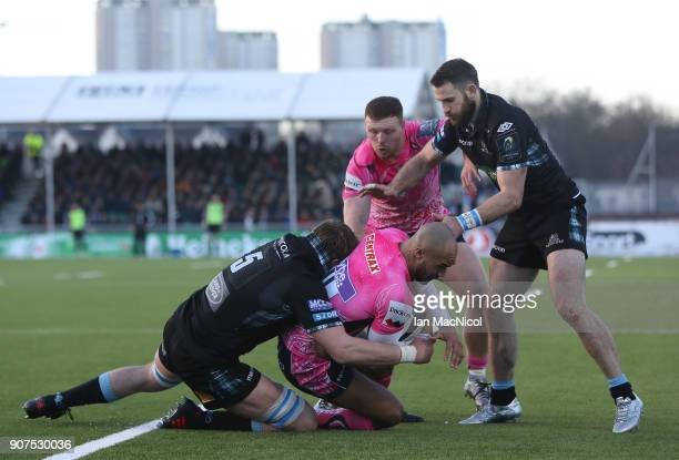 Olly Woodburn of Exeter Chiefs is tackled by Jonny Gray of Glasgow Warriors during the European Rugby Champions Cup match between Glasgow Warriors...