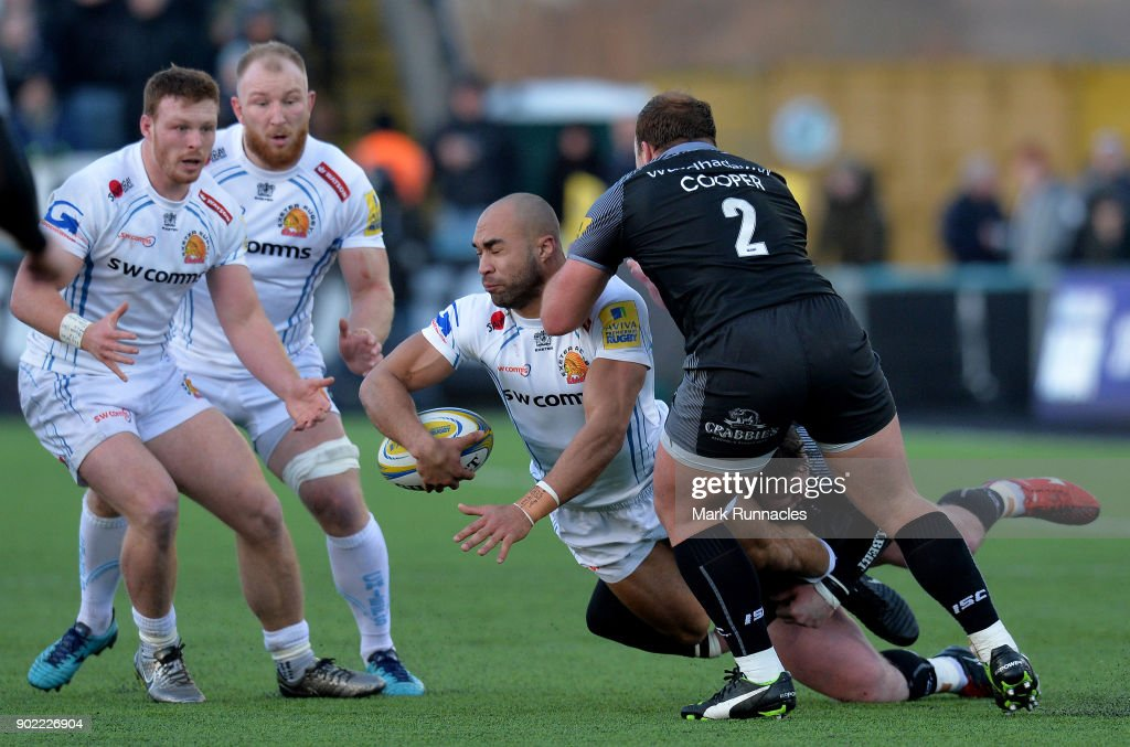 Olly Woodburn of Exeter Chiefs is tackled by Michael Young and Kyle Cooper of Newcastle Falcons during the Aviva Premiership match between Newcastle Falcons and Exeter Chiefs at Kingston Park on January 7, 2018 in Newcastle upon Tyne, England.