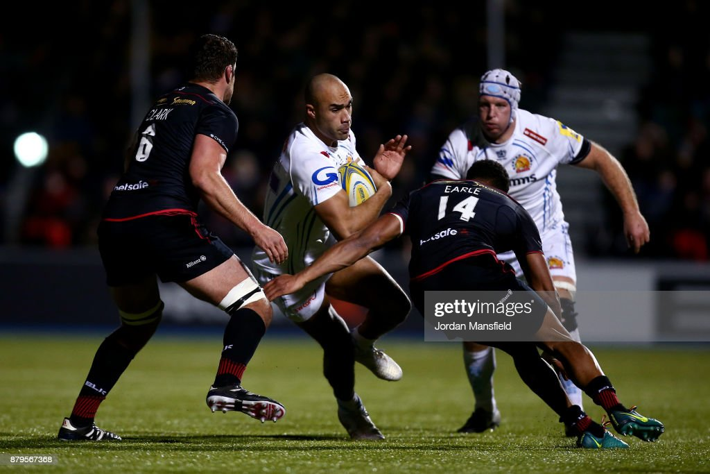 Olly Woodburn of Exeter is tackled by Nathan Earle and Christopher Tolofua of Saracens during the Aviva Premiership match between Saracens and Exeter Chiefs at Allianz Park on November 26, 2017 in Barnet, England.