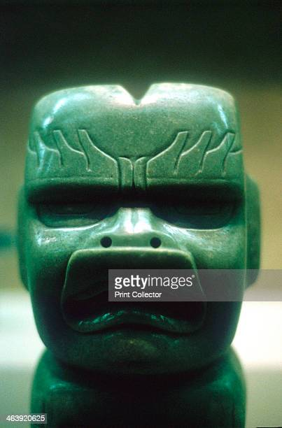 Olmec carved jade head PreColumbian Central America 1150800 BC A carved head possibly representing a dragon