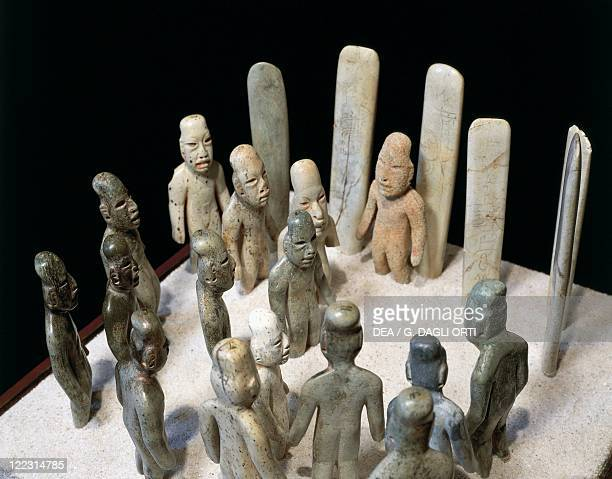 Olmec civilization Mexico 9th4th century bC Ceremony of offerings figures and stele in jade From La Venta