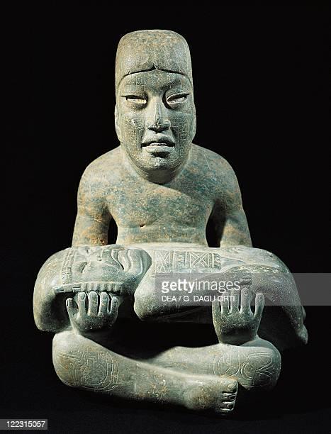 Olmec civilization Mexico 9th4th century bC Jadeite sculpture depicting a man carrying a half man/half feline creature From Las Limas VeracruzLlave...