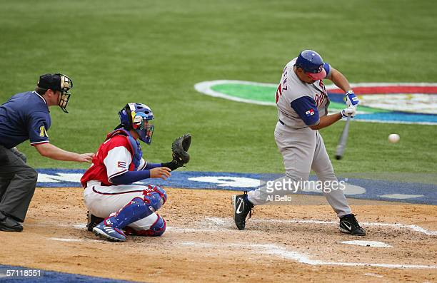 Olmedo Saenz of Panama swings at the pitch against Cuba during the World Baseball Classic at Hiram Bithorn Stadium on March 8 2006 in San Juan Puerto...