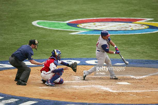 Olmedo Saenz of Panama swings at the pitch during the game against Cuba during the World Baseball Classic at Hiram Bithorn Stadium on March 8 2006 in...