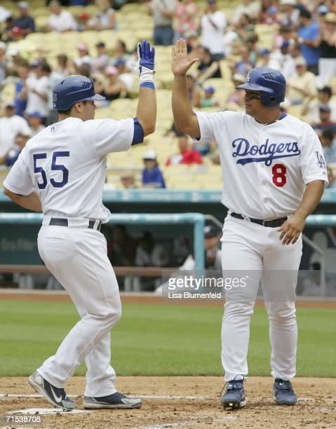 Olmedo Saenz of the Los Angeles Dodgers congratulates teammate Russell Martin on hitting a tworun home run in the 1st inning against the Washington...