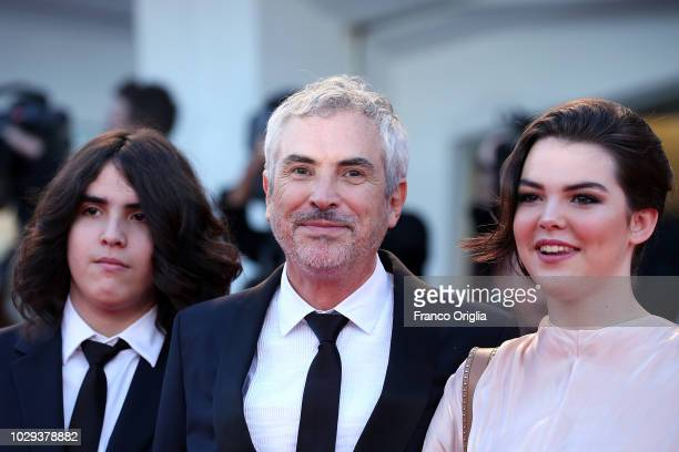 Olmo Teodoro Cuaron Alfonso Cuaron and Tess Bu Cuaron walk the red carpet ahead of the Award Ceremony during the 75th Venice Film Festival at Sala...