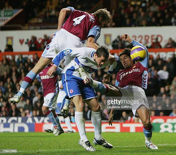 Olof Mellberg and Milan Baros of Villa battle with Andrew Taylor of Boro during the Barclays Premiership match between Aston Villa and Middlesbrough...